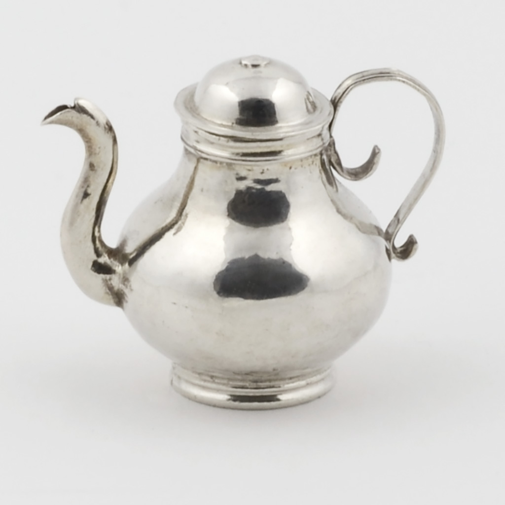 A Toy Silver George I Teapot.
