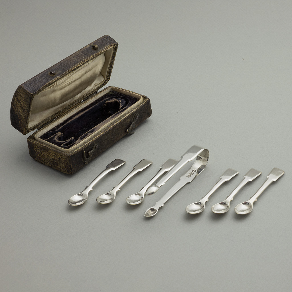 A Set Of George III Toy Silver Spoons And Tongs.