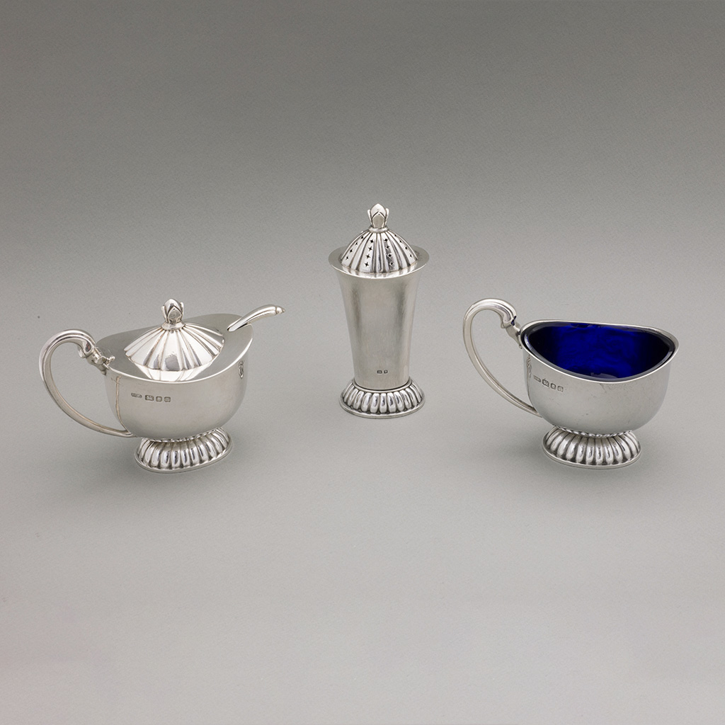 An Arts And Crafts Silver Condiment Set.