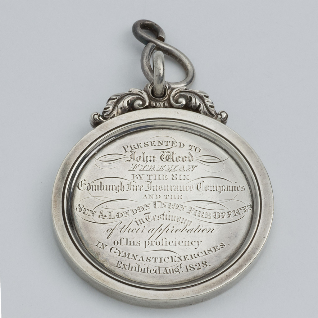 A George IV Scottish Silver Fireman's Medal.