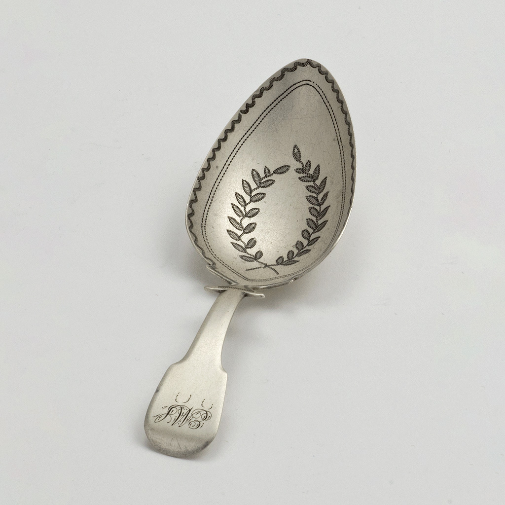A Large George III Silver Caddy Spoon.