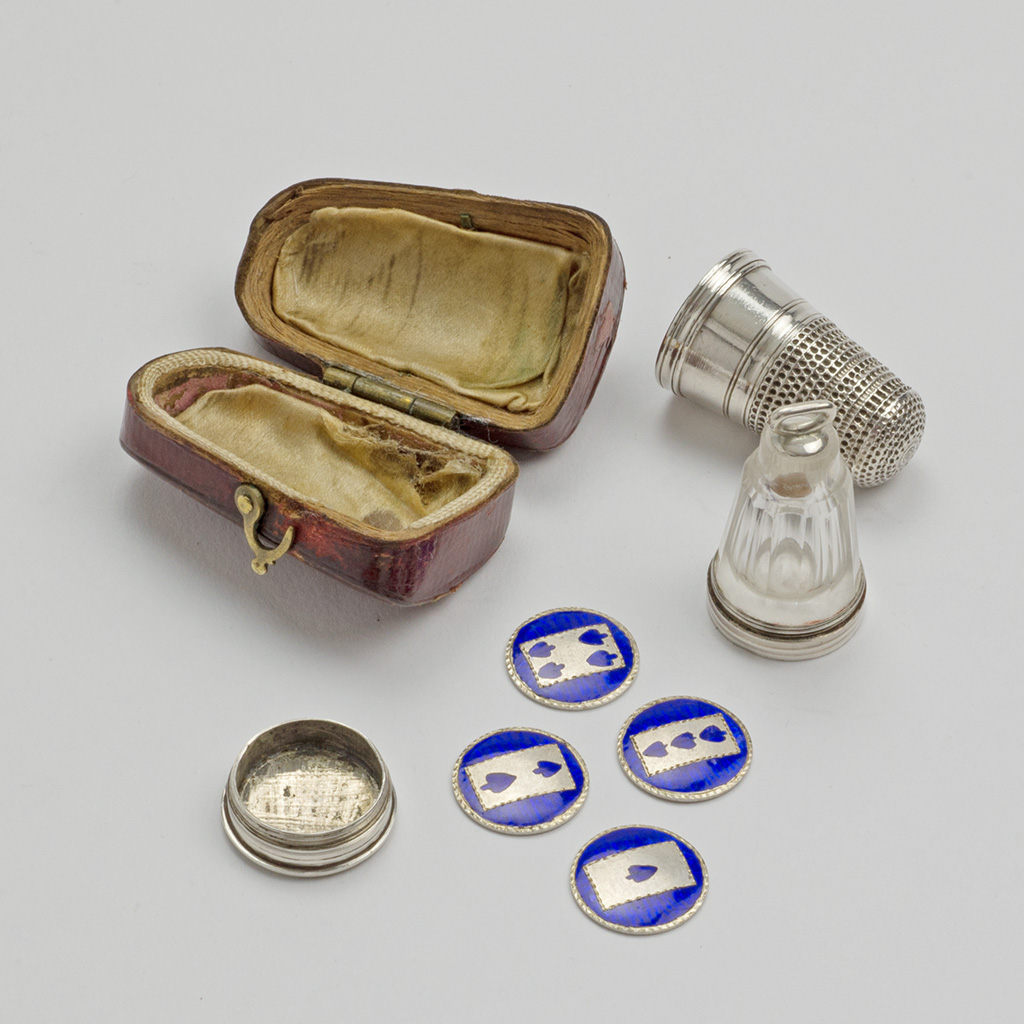 An Unusual George III Silver Thimble Compendium With Counters And Scent Bottle.