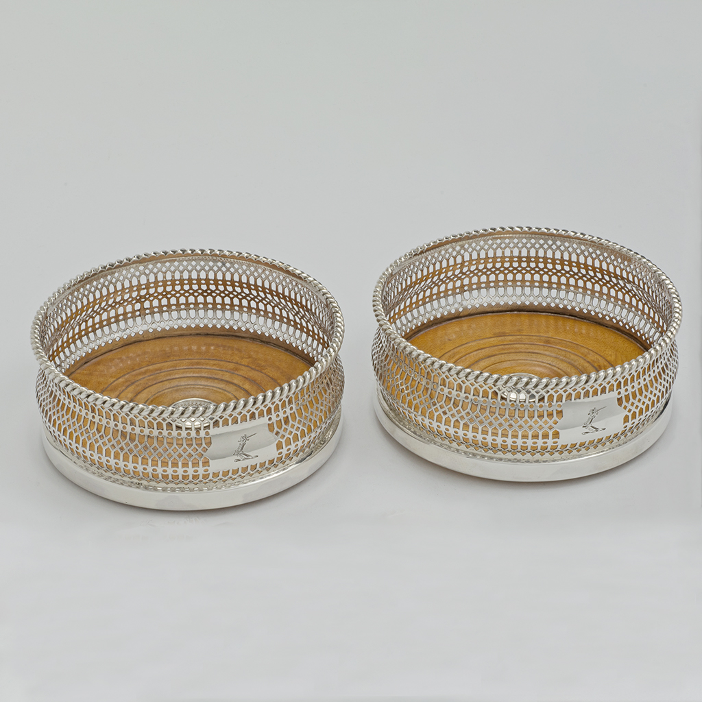 A Pair Of Victorian Silver Wine Coasters.