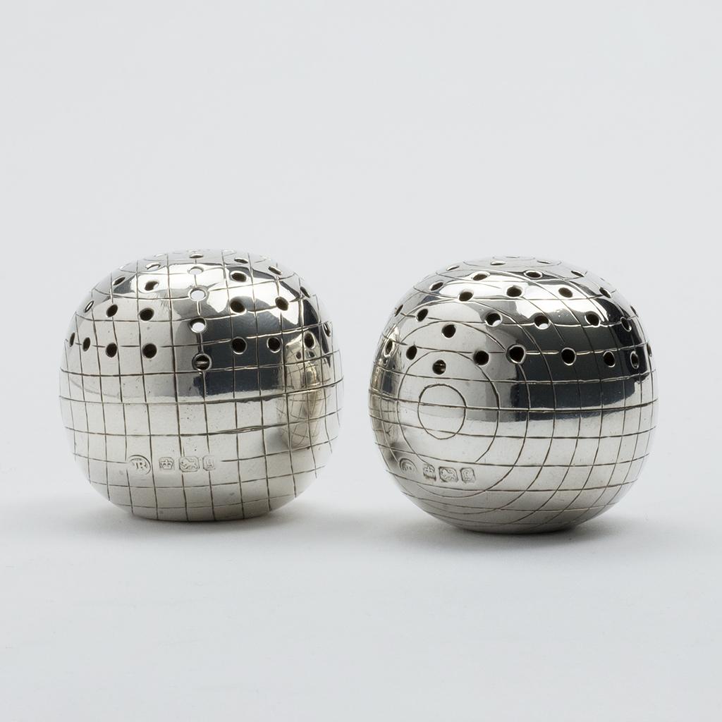 A Pair Of Late Victorian Silver Croquet Ball Pepper Pots.