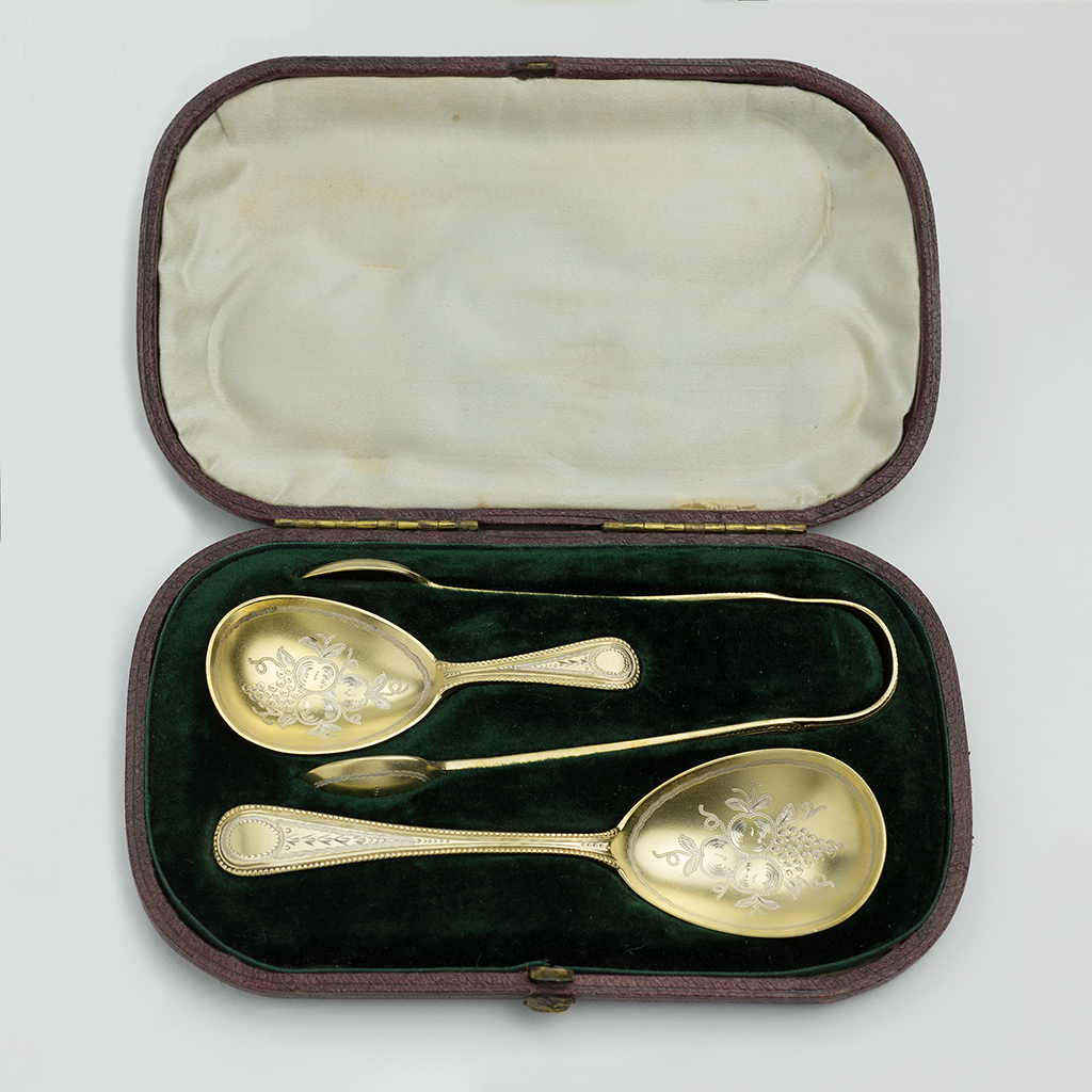 A Victorian Silver-gilt Set Of Caddy Spoon, Tongs And Sugar Spoon.