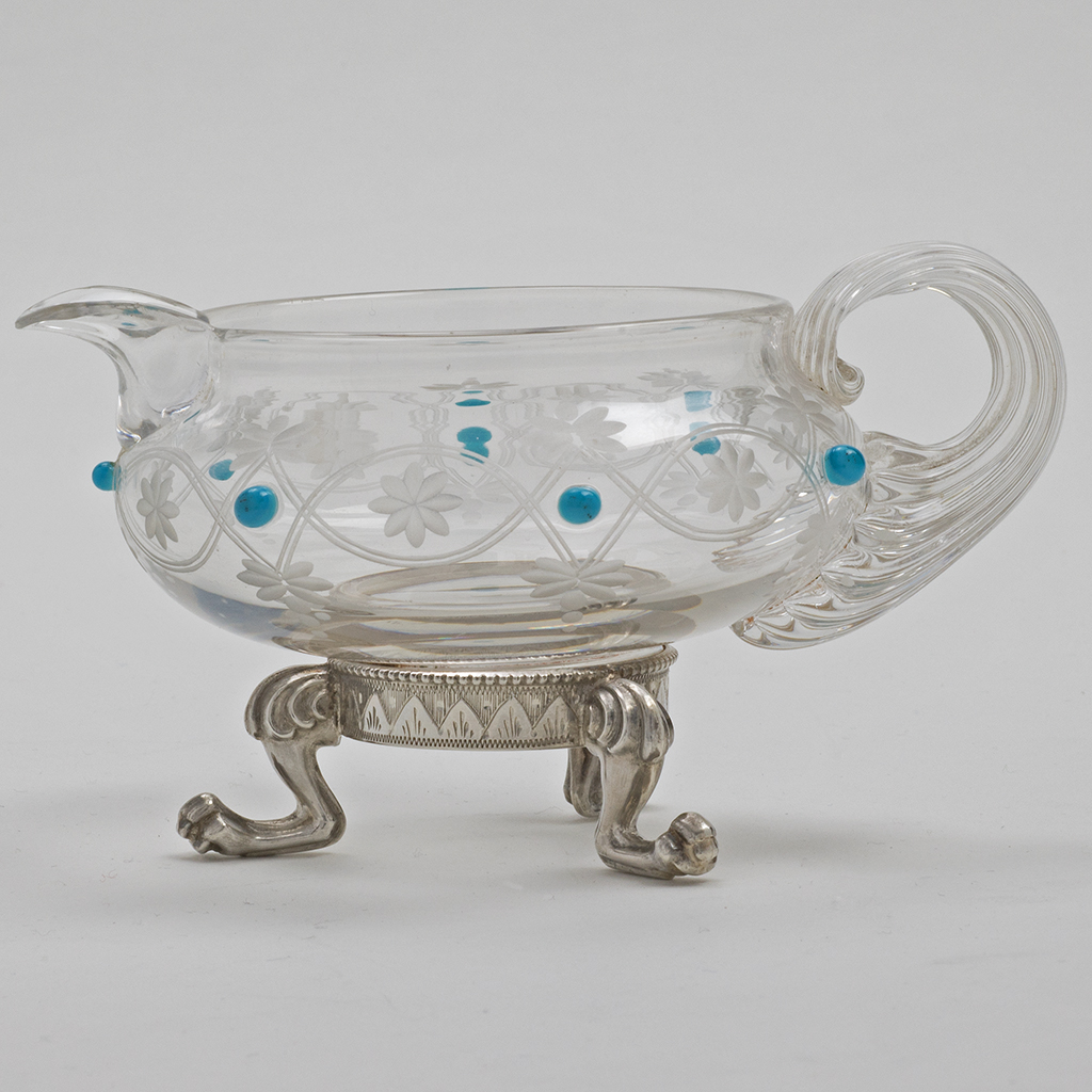 A Victorian Silver Mounted Glass Cream Jug.