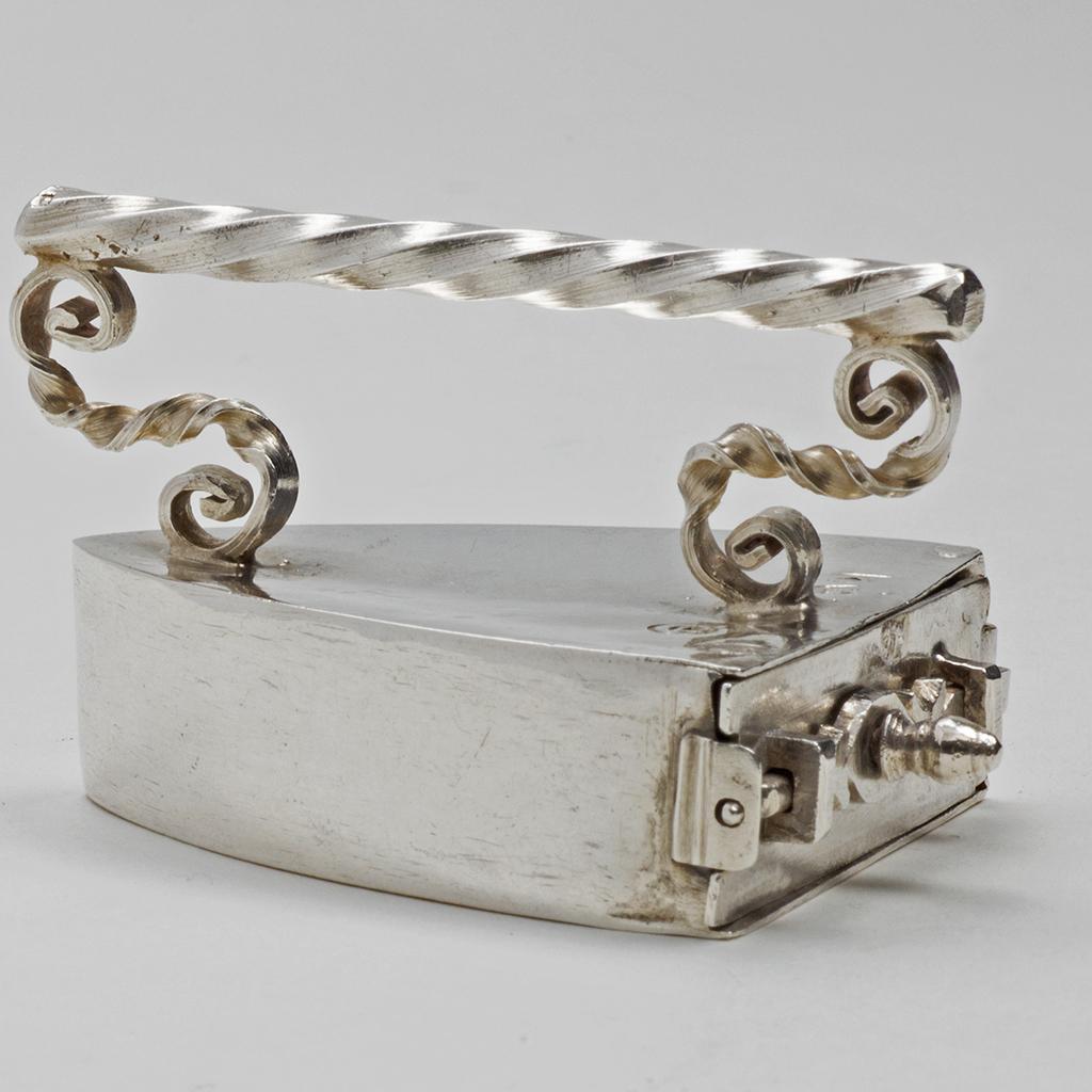 A 17th Century English Toy Silver Flat Iron.