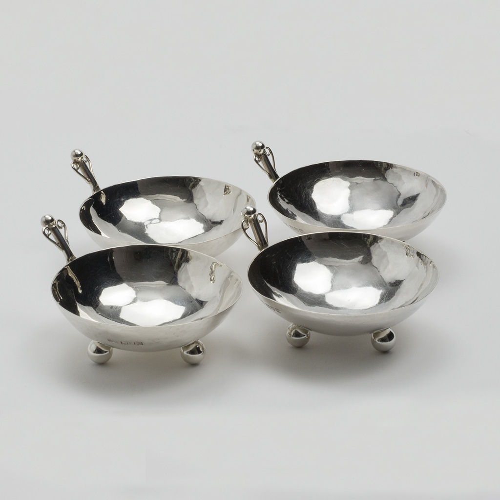 A Set Of Four Arts And Crafts Silver Dishes.