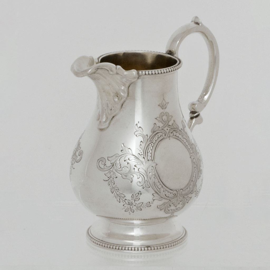A Victorian Silver Cream Jug.