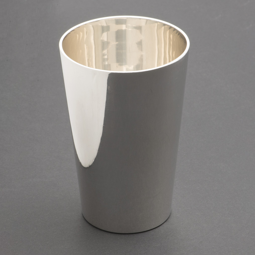 A Very Plain Large Silver Beaker.