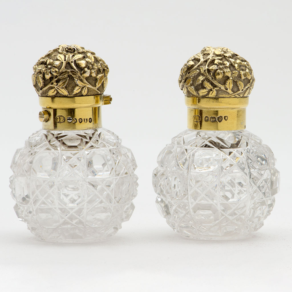 A Pair Of Victorian Miniature Spherical Silver And Glass Scent Bottles.
