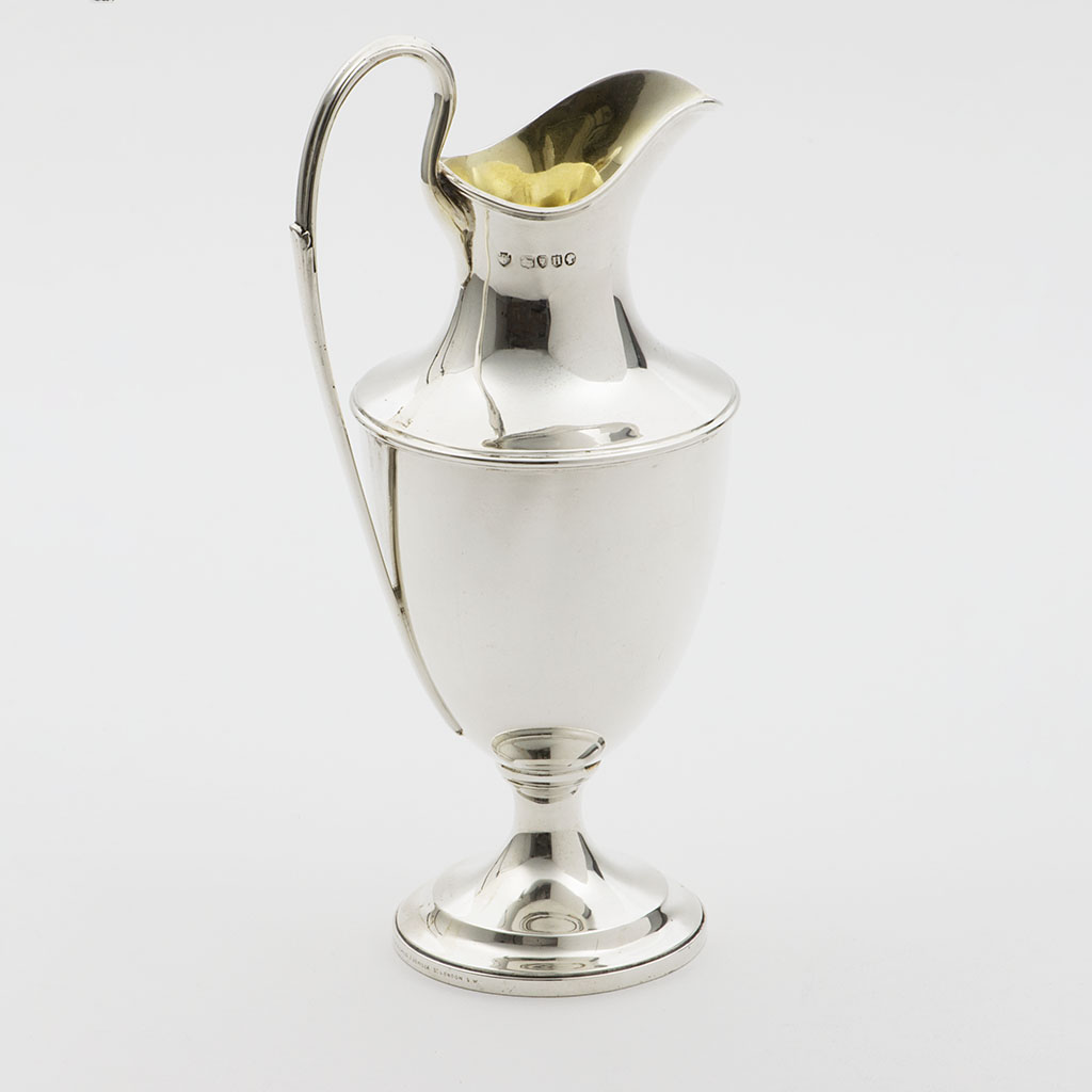 A Large Victorian Silver Cream Jug.