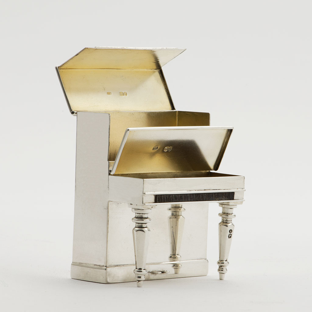 A Victorian Novelty Silver Match And Cigarette Case Formed As A Piano.