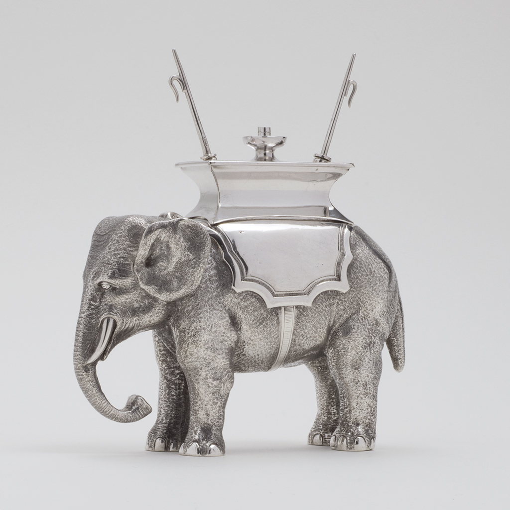 An Unusual Victorian Silver Regimental Table Lighter Formed As An Elephant.