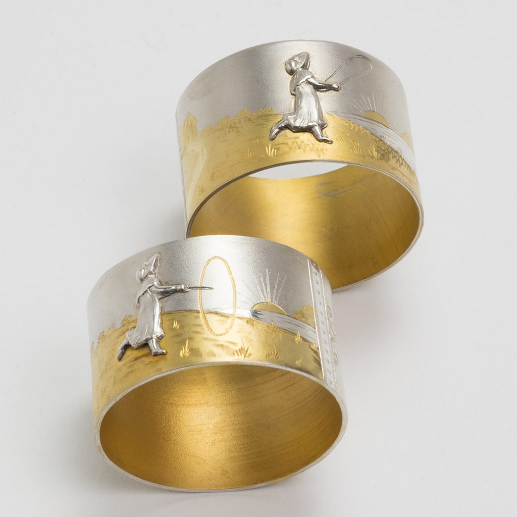A Pair Of Victorian Silver Napkin Rings With ' Kate Greenaway' Decoration.