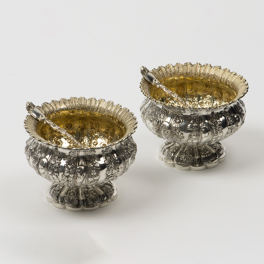 A Pair Of George IV Silver Salt Cellars With Later Spoons.