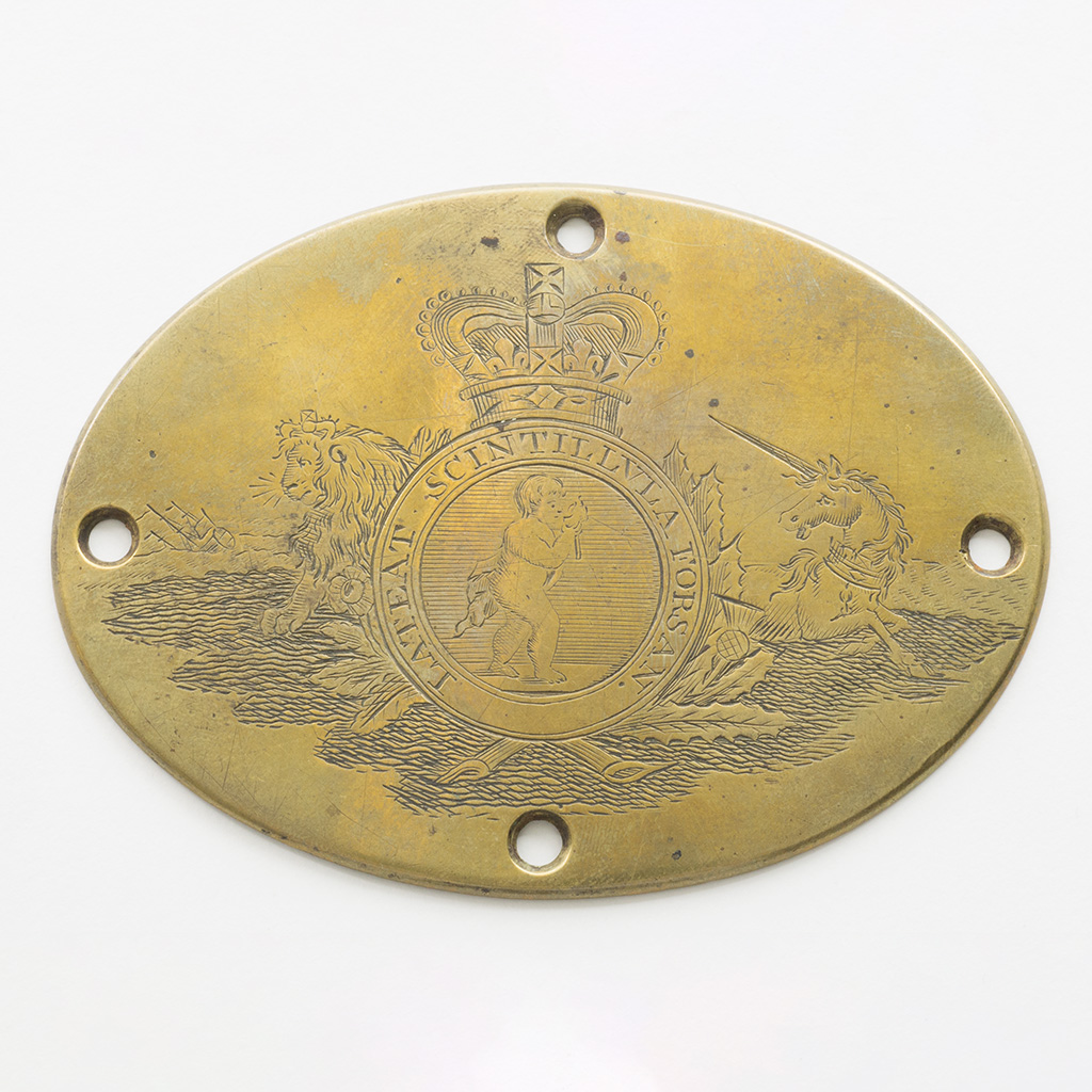 An 18th Century Brass Plaque Finely Engraved With The Arms Of The Royal Humanitarian Society.
