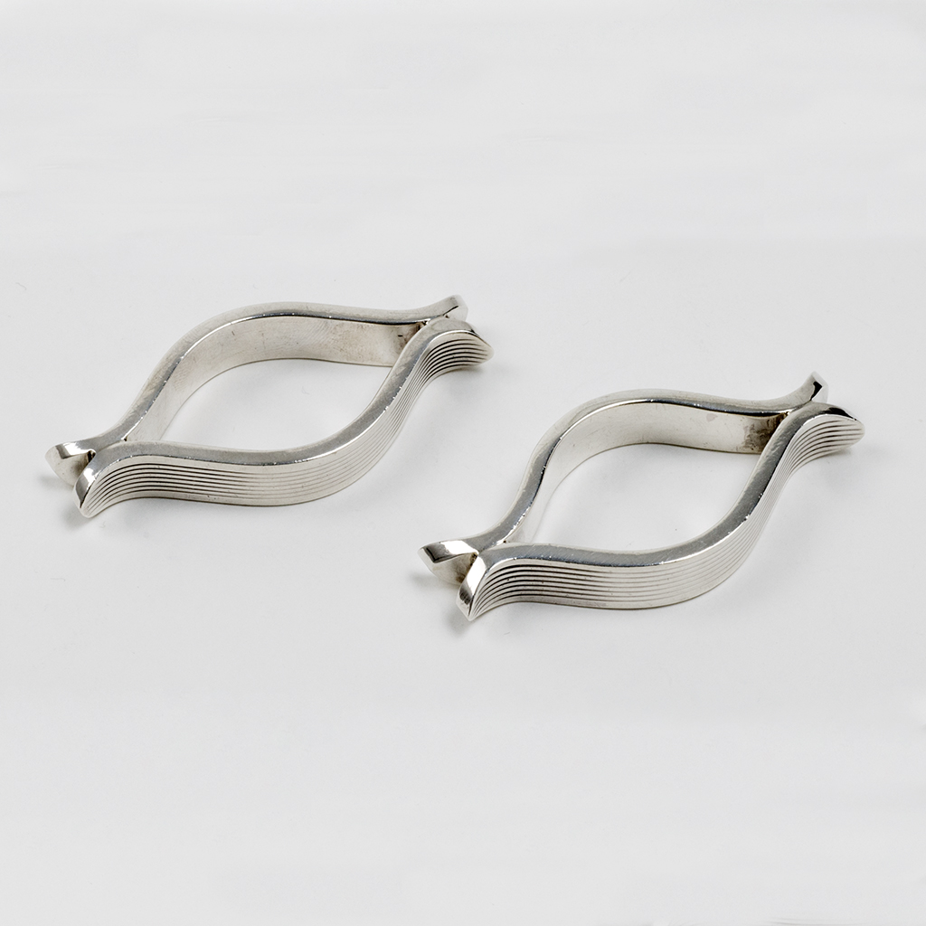 A Pair Of Modernist Silver Napkin Rings Designed By Geoffrey Bellamy.