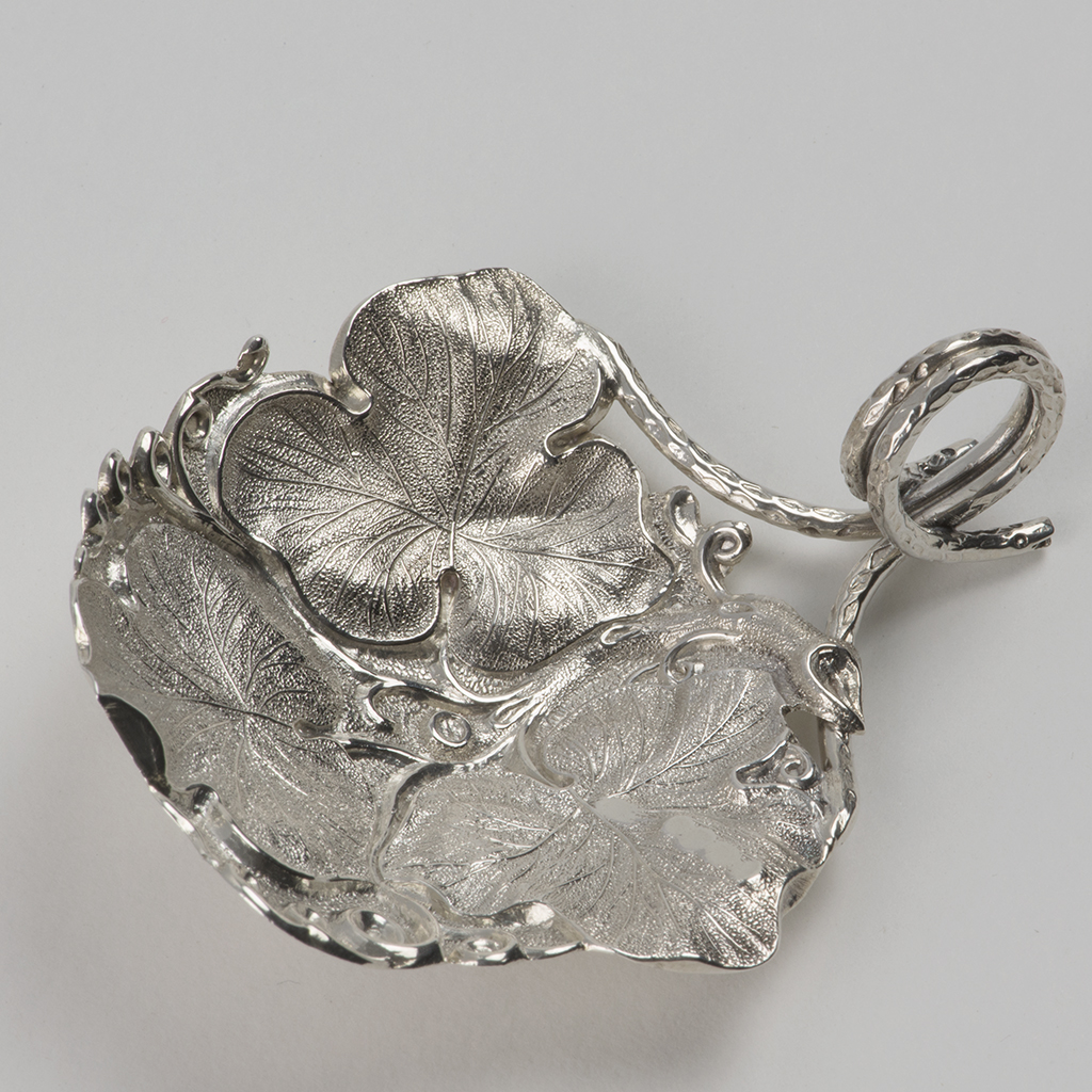 A George IV Silver Caddy Spoon Formed From Vine Leaves.