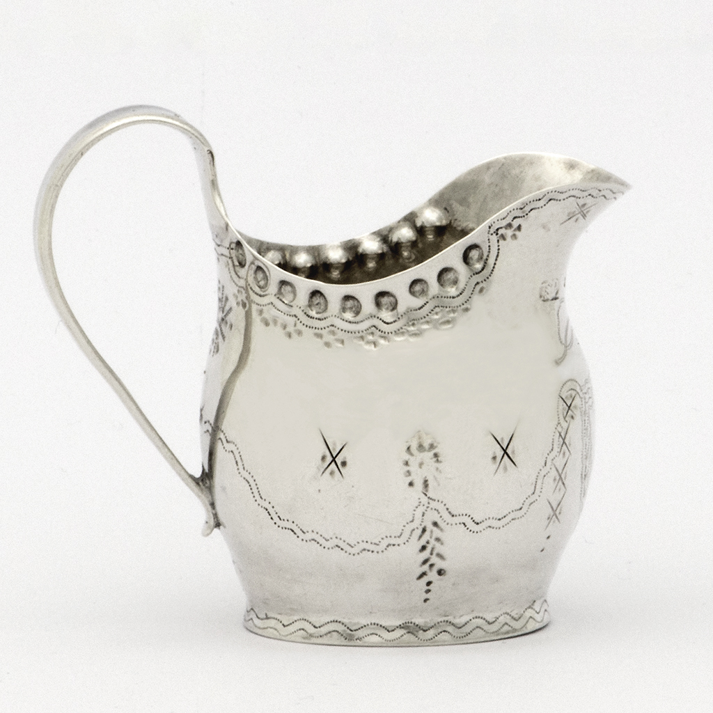 A George IV Exeter Silver Toy Jug.