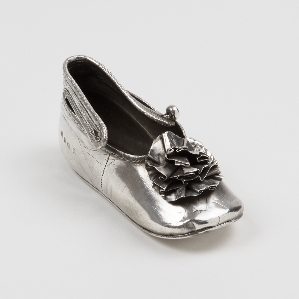 A George V Silver Model Of A Baby's Shoe.