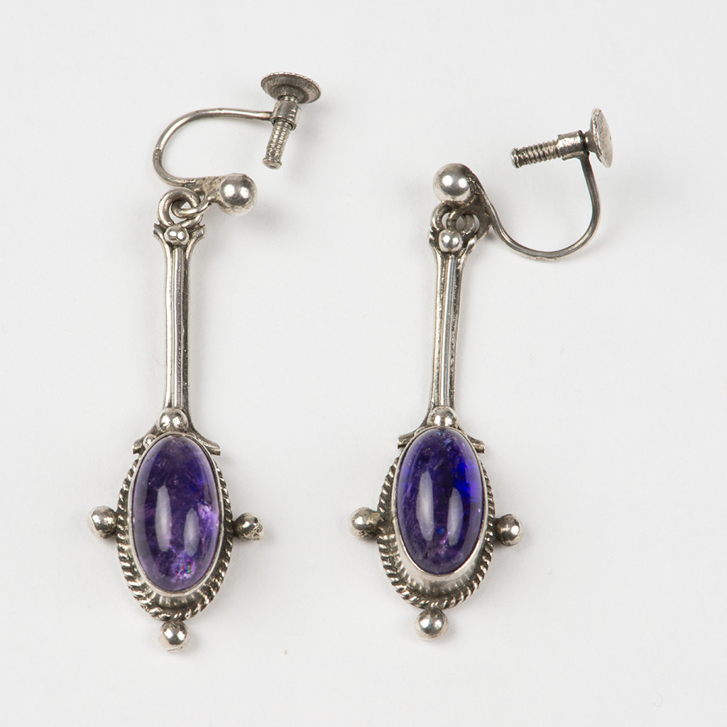 A Pair Of Arts And Crafts Silver Earrings By Tom Stewart.