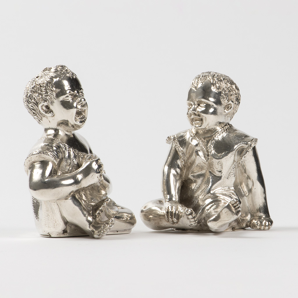 A Pair Of Victorian Novelty Silver Pepper Pots Formed As Children.
