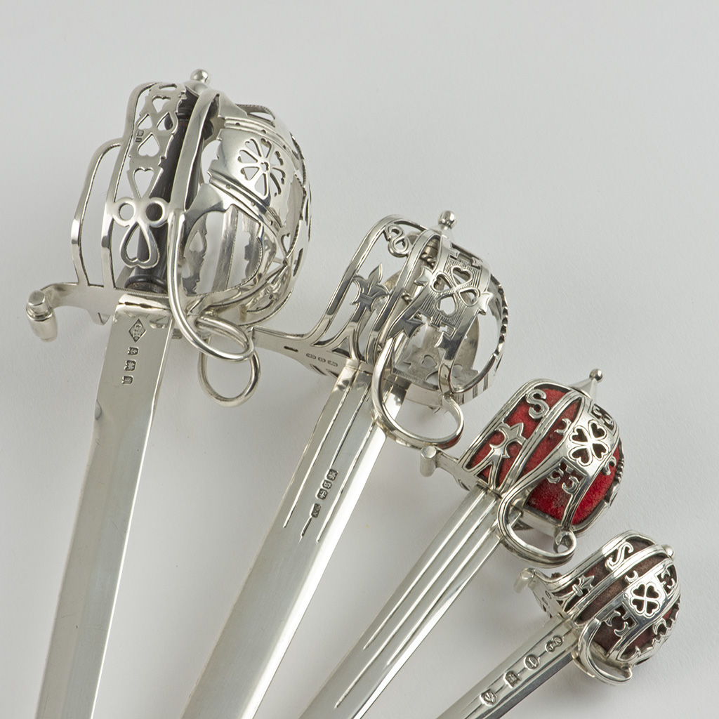 A Collection Of Silver Broadsword Letter Openers.