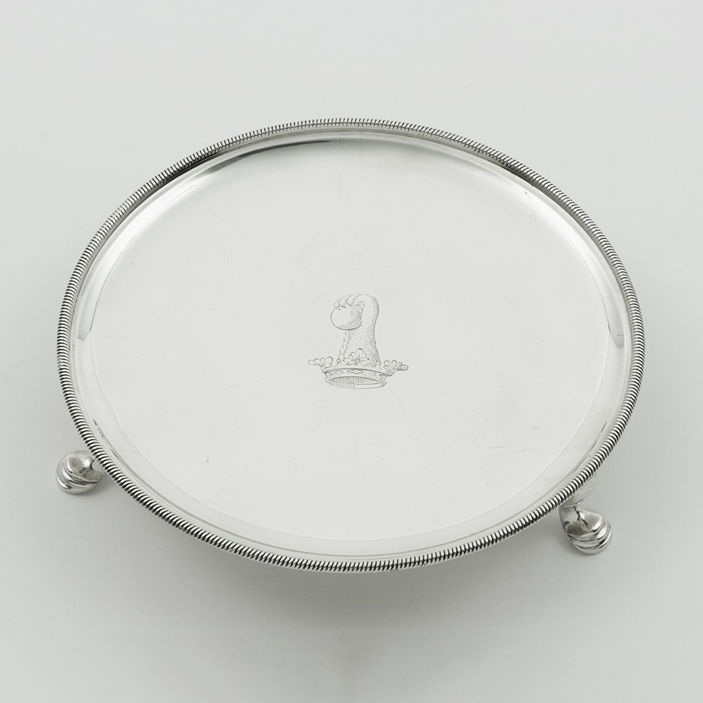 A George II Silver Waiter With A Knurled Border.