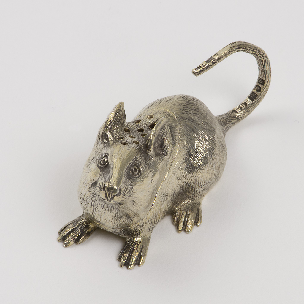 A Tiny Silver Pepper Pot In The Form Of A Mouse.