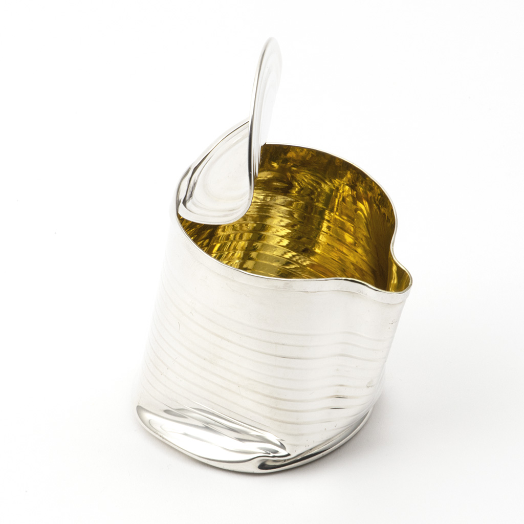 A 'crushed Can' Modern Silver Jug.