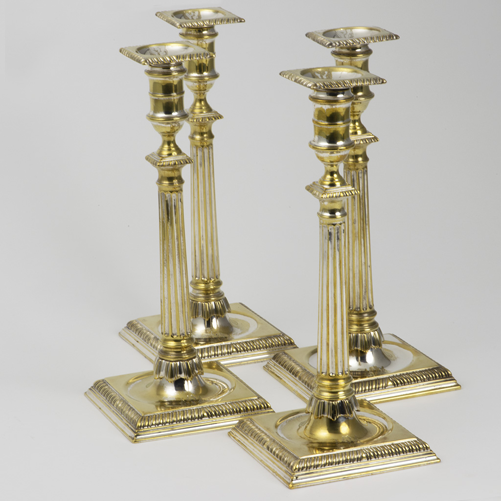 A Set Of Four George III Brass Candlesticks With Extensive Remains Of Silvering.