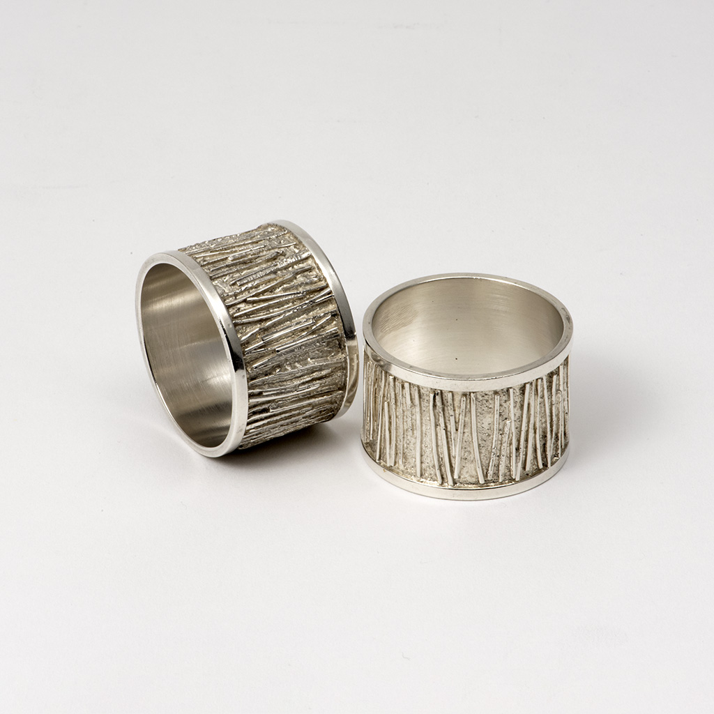 A Pair Of Graham Watling Napkin Rings.