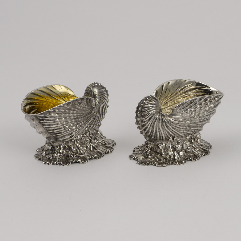 A Pair Of William IV Silver Nautilus Shell Salt Cellars.
