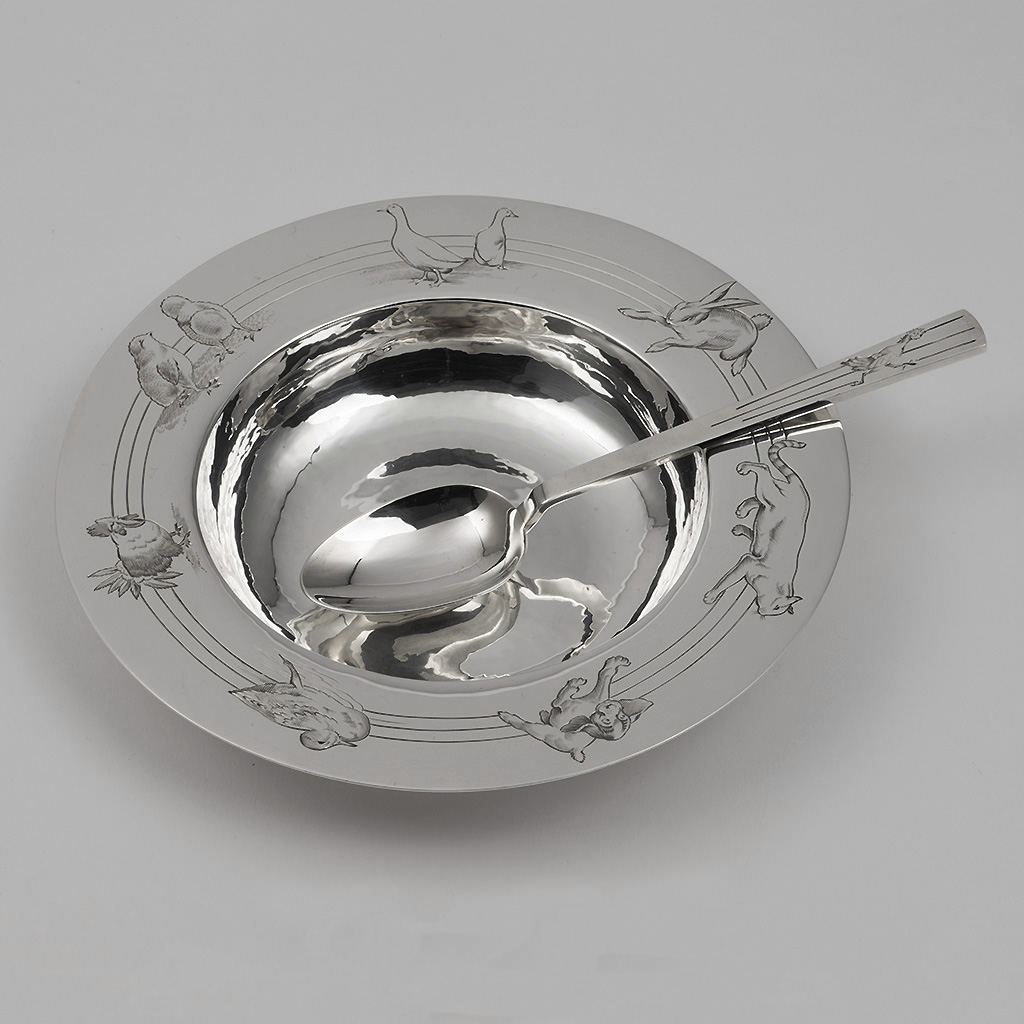 A Child's Silver Bowl And Spoon BY R.E. Stone