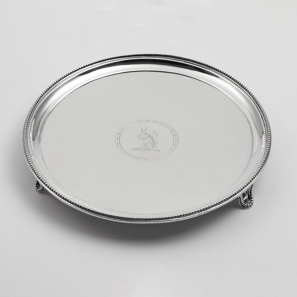 A George III Bead-edged Silver Waiter.