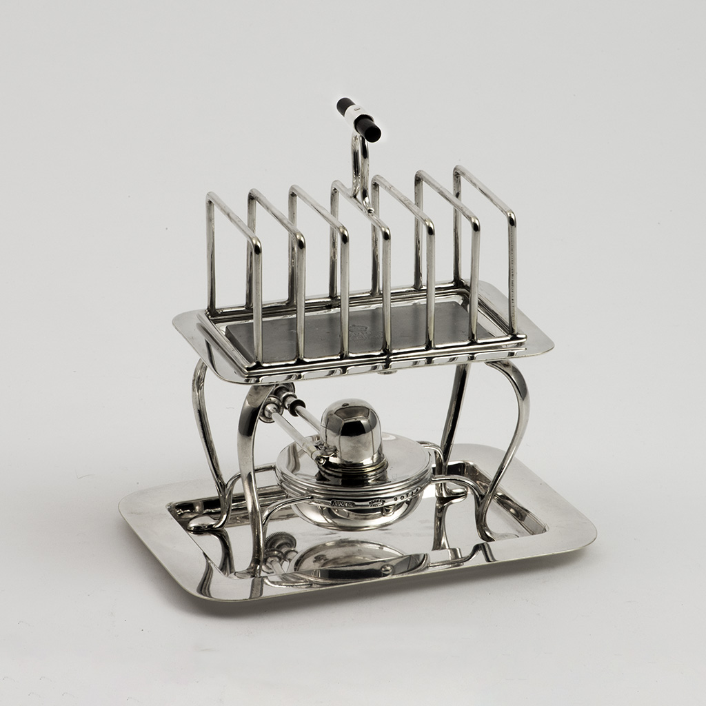 An Asprey And Company Novelty Electroplated Toastrack And Warmer.