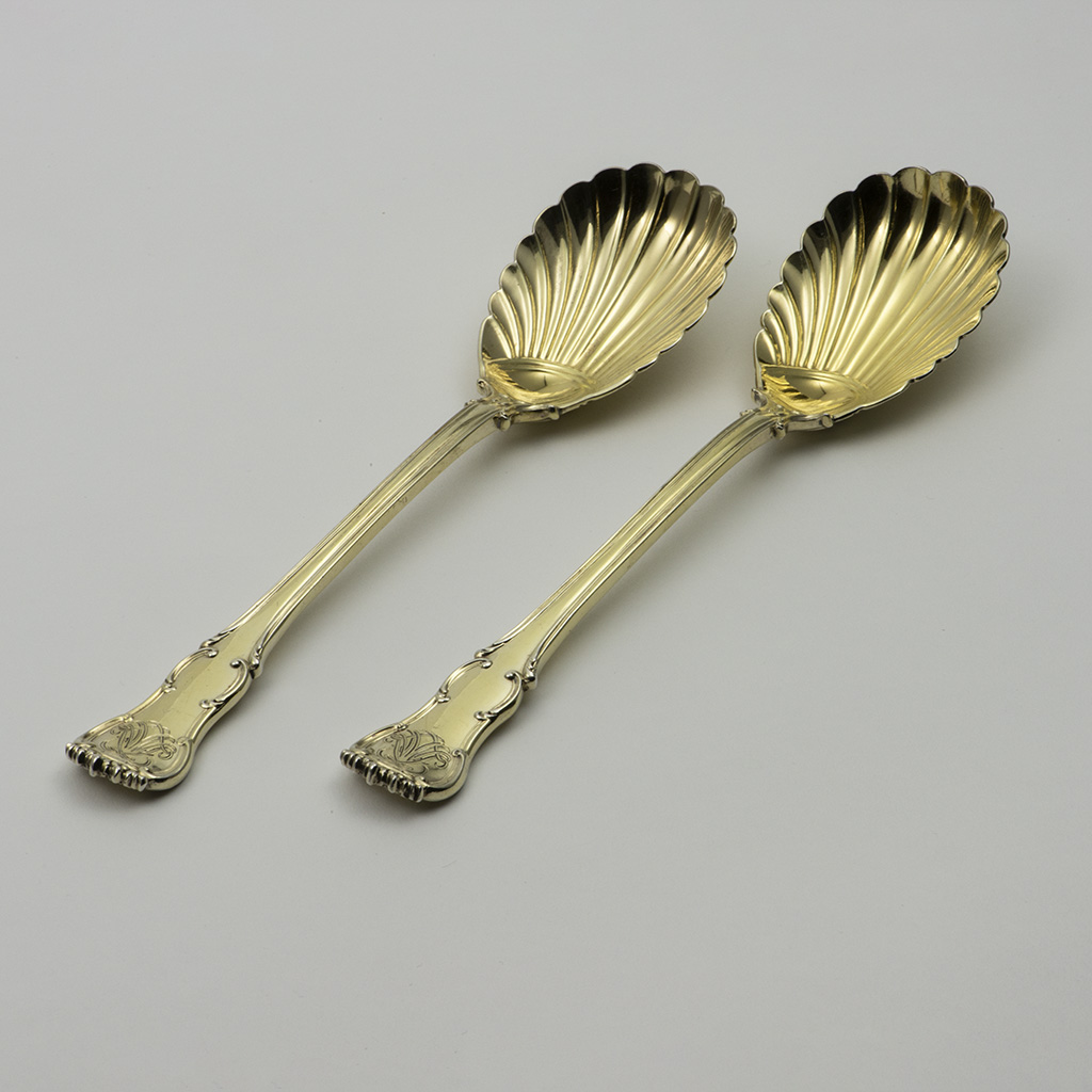 A Pair Of Victorian Silver-gilt Fruit Servers.