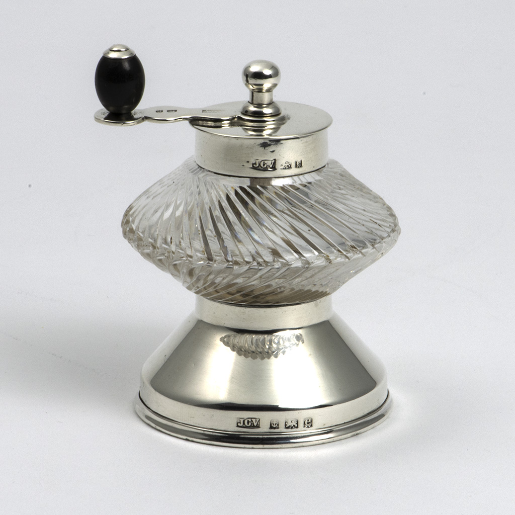 A Silver And Glass Pepper Grinder.