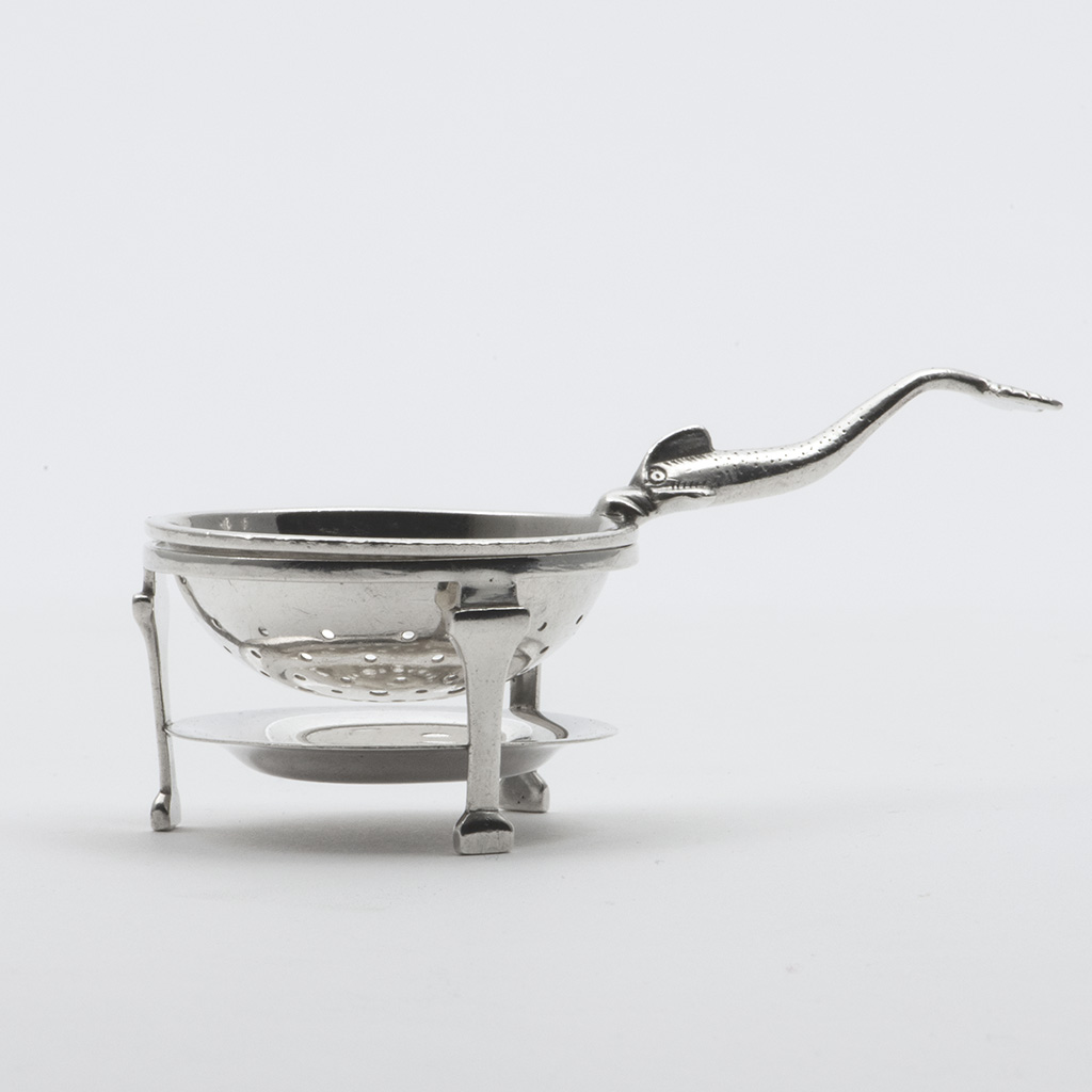 A Scottish Silver Tea Strainer And Stand Modelled On A Spoon In The Traprain Silver Hoard.