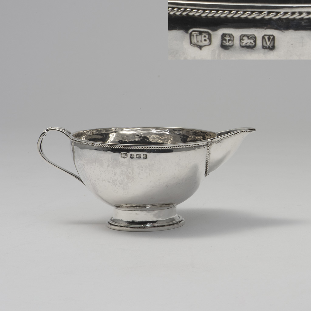 An Arts And Crafts Silver Jug.