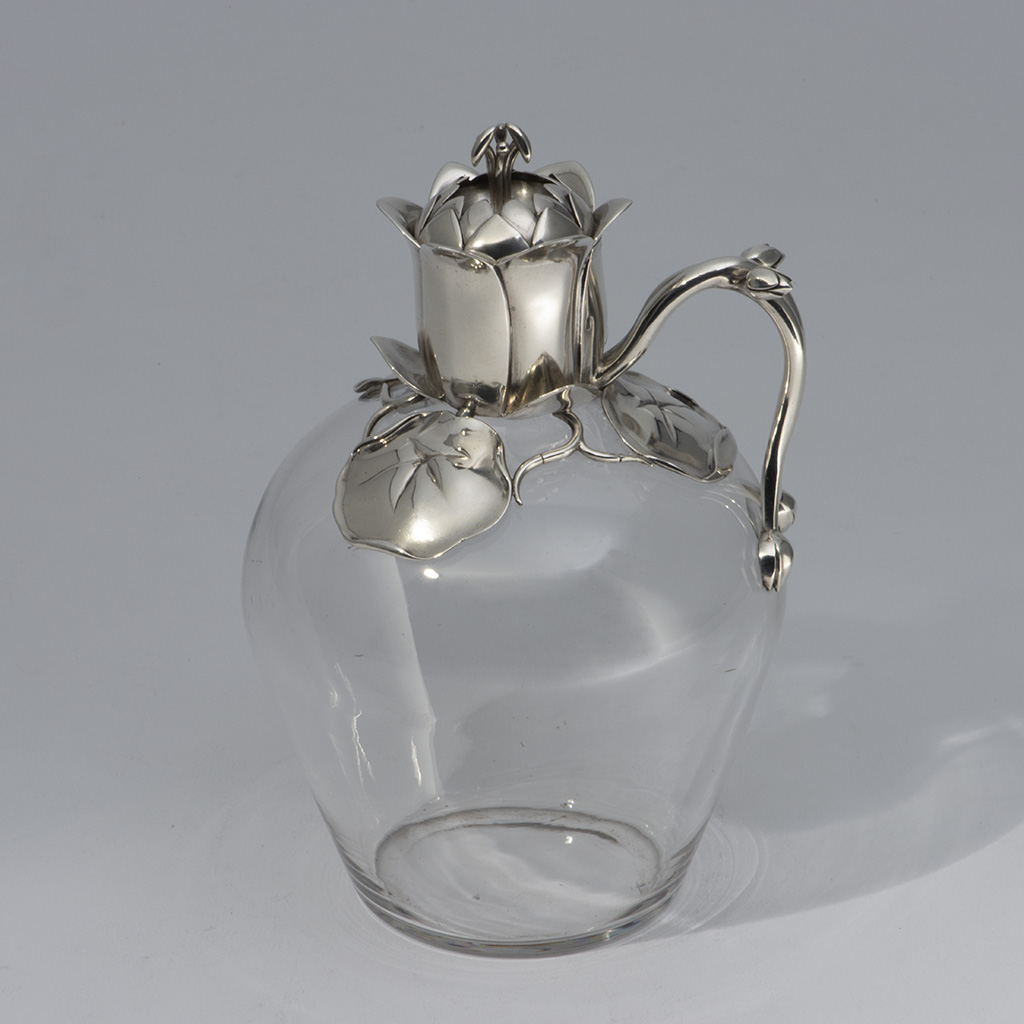 A Victorian Naturalistic Silver Mounted Claret Jug.
