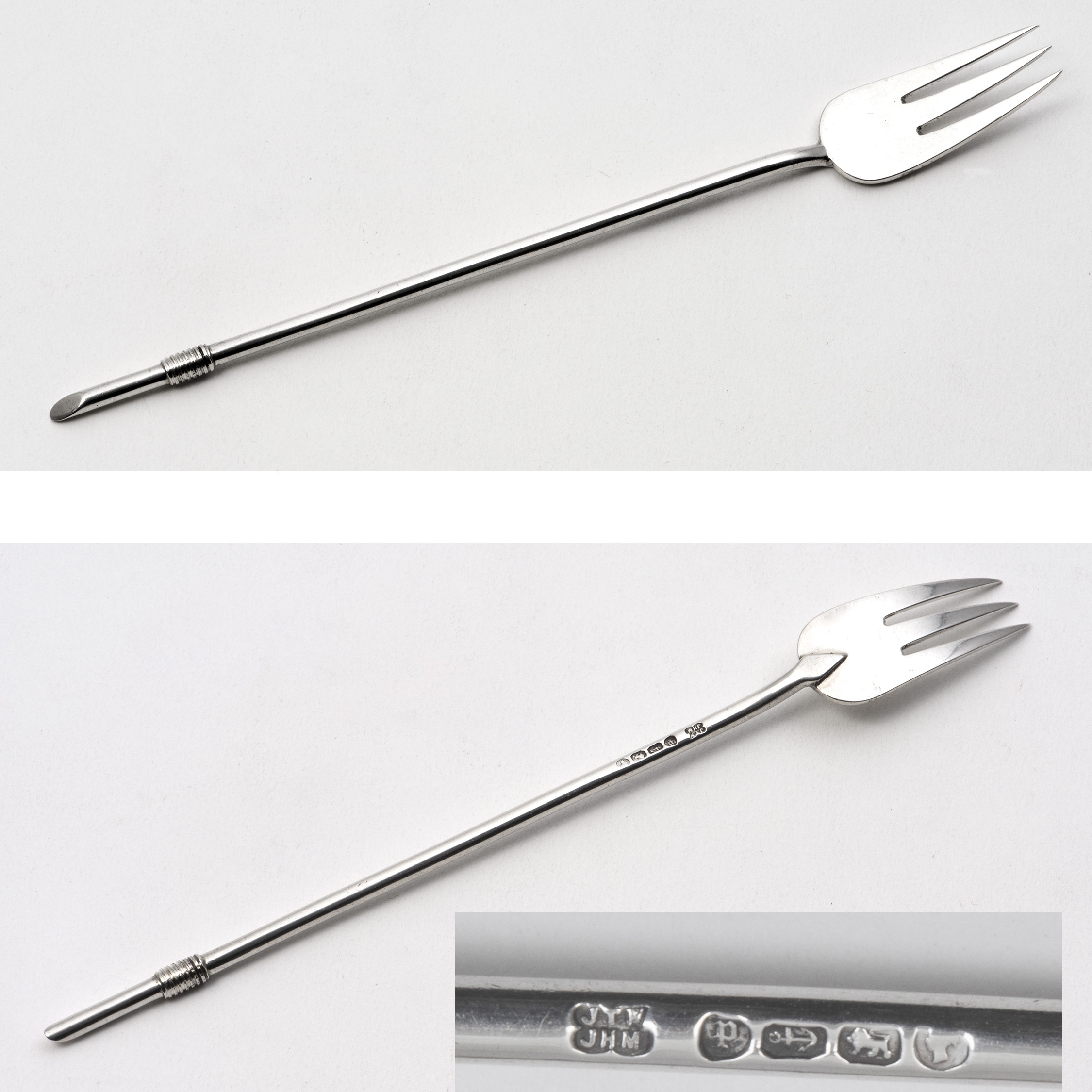 A Small Serving Fork By Hukin And Heath.